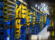 Data center with blue and yellow cables running between servers.